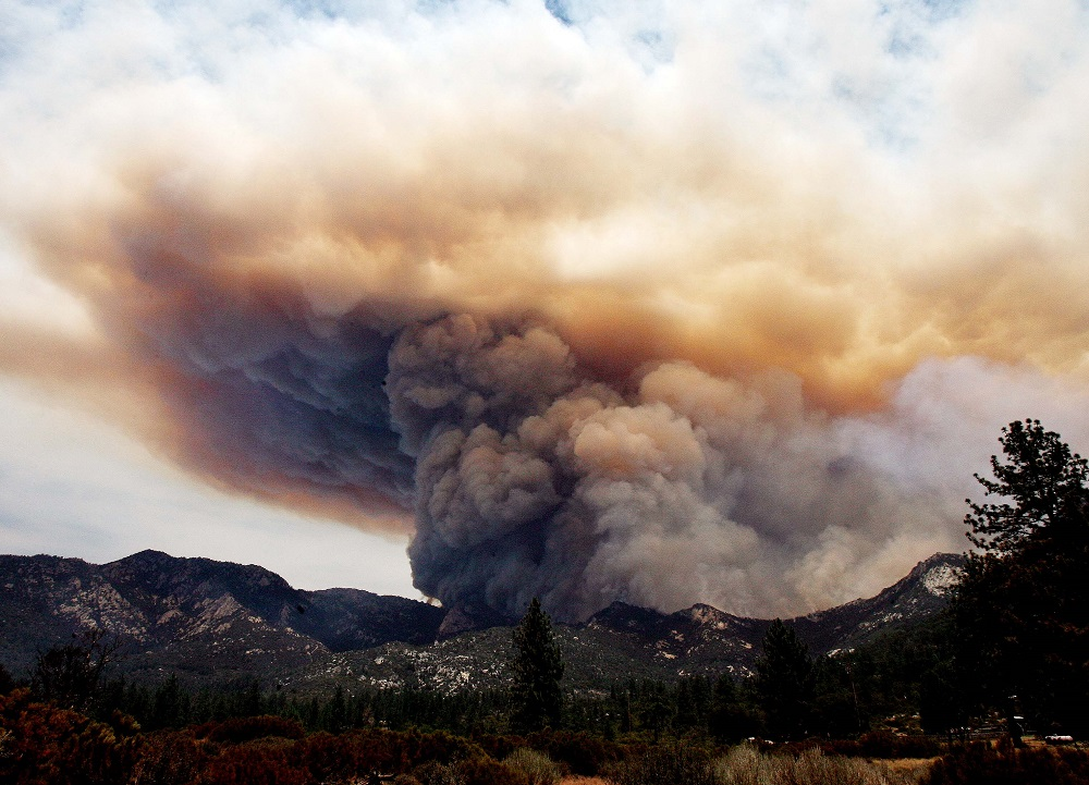 . The Mountain Fire near Lake Hemet pours smoke into the sky Tuesday July 16, 2013. The 14,200 acre forest fire near Idyllwild Calif., has caused Idyllwild and adjacent communities east of Highway 243 to issued mandatory evacuations for hundreds of homes Wednesday. (AP Photo/The Press-Enterprise, Frank Bellino)