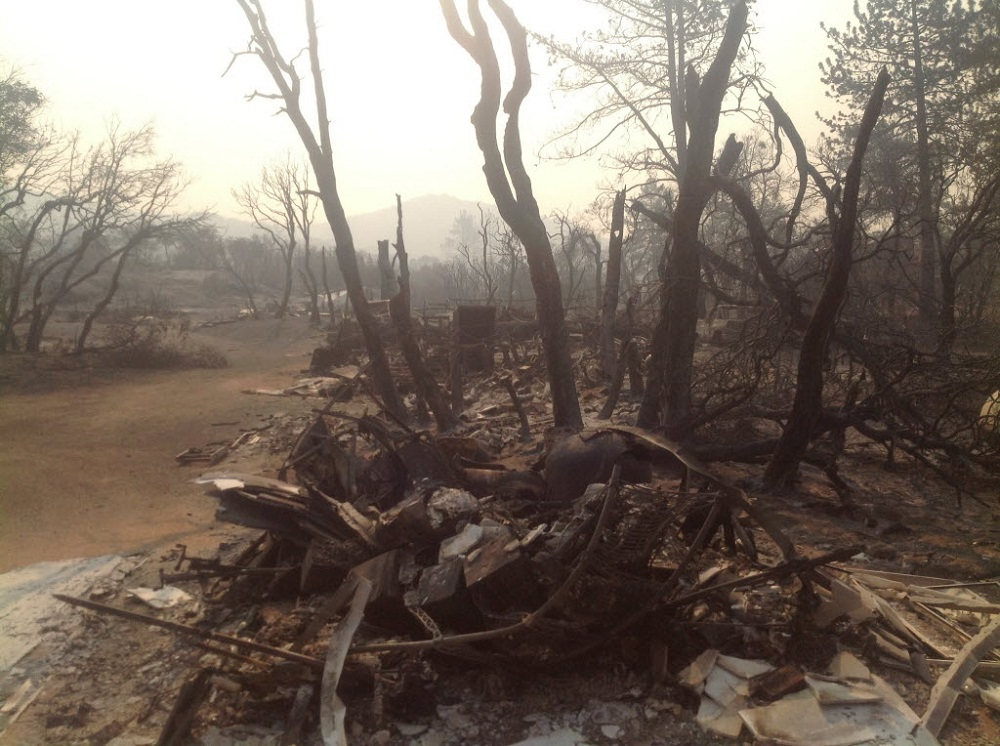 . The charred remains of homes and trees are shown in the Bonita Vista area near Idyllwild, Calif., Wednesday, July 17, 2013. Large parts of the Southern California communities of Idyllwild and Fern Valley were under evacuation orders with an estimated 300 to 400 homes affected, according to U.S. Forest Service spokeswoman Carol Jandrall. (AP Photo/Press Enterprise, John Ashbury)