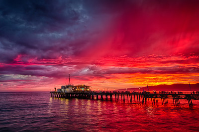 """Pier Red Sunset #3"" Santa Monica, CA  19"" x 13"" archival print  $700 framed - 24"" x 18"" frame with white mat  $500 unframed print with white mat  Signed & Numbered Limited Edition of 5 of this size"