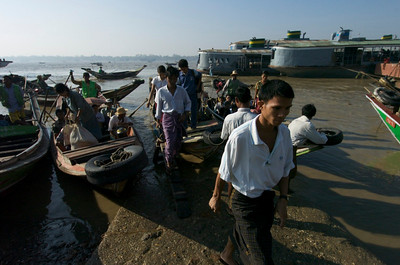 Commuters coming off the boat from across the Irrawaddy in Rangoon, Burma.  February 2008