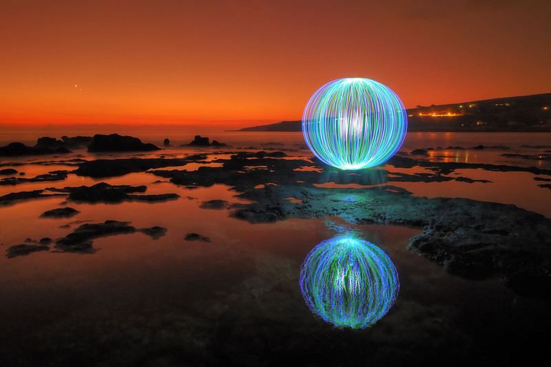 This was my first attempt at light painting a sphere outdoors.   I worked on this shot for over 3 hours trying to get just the right combination of exposure and timing...   I had some home-made equipment malfunctions and my motorcycle battery died on this trip... but, through all the difficulties, I was pleased with the result.  This was shot at the tide pools near Hulopo'e Bay on the island of Lana'i.  1/11/15