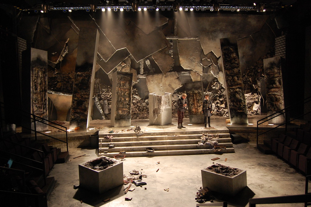 "<h2>JULIUS CAESAR (Writers Theater)</h2> <br><h4>""replete with designer Courtney O'Neill's vision of the explosion of a superpower, crumbling pillars, rubble and all. This must be the biggest set <strong>O'Neill, a long-standing Chicago asset, </strong>ever has designed. By an order of magnitude."" --Chicago Tribune <p>""The play unfolds against Mike Tutaj's projections on Courtney O'Neill's imposing set... <strong>O'Neill masterfully conveys the before and after of the doomed republic</strong>."" --Daily Herald</p></h4>"