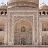 The Taj Mahal. Notice the ornate Arabic calligraphy around the central arch.