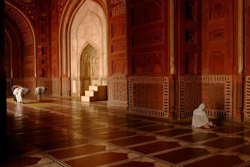Prayer time at the mosque in the Taj Mahal complex. In public, women and men always pray in segregated areas.