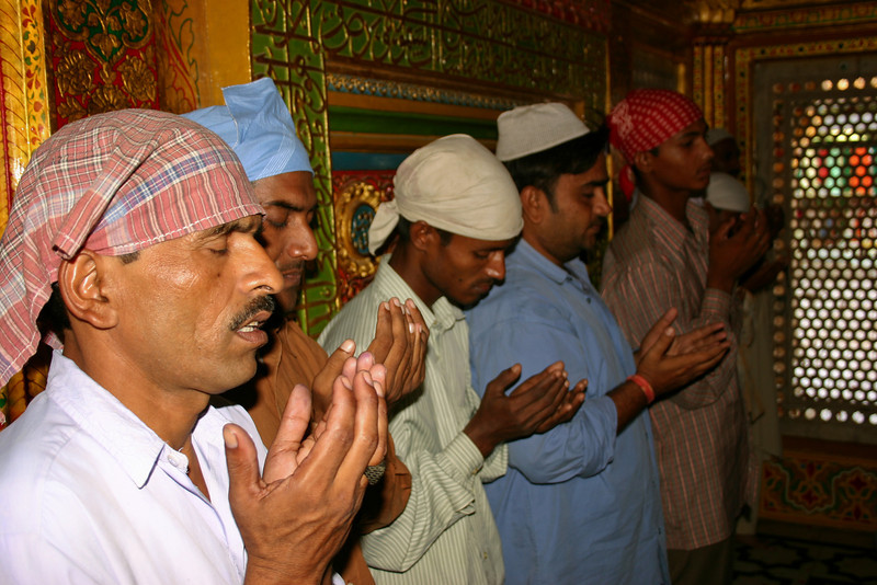 Supplicants praying at the Muslim shrine of Hazrat Nizamuddin in Delhi