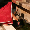A woman washes for prayers at the shrine of Hazrat Nizamuddin in Delhi