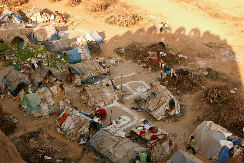 Slum dwellings in the shadow of a luxurious royal tomb of old, in Delhi