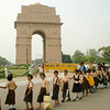 School children march along in front of the India Gate, a war memorial in New Delhi