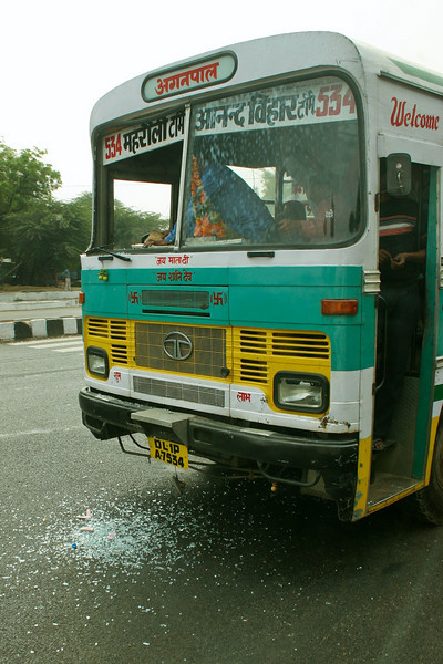 I was riding along in a bus in Delhi when all of a sudden there was a loud crashing noise. I looked out the window and saw that the windshield of the bus next to mine had just broken out, for no apparent reason.