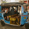 Children on their way home from school in an auto-rickshaw, Chandigarh, India