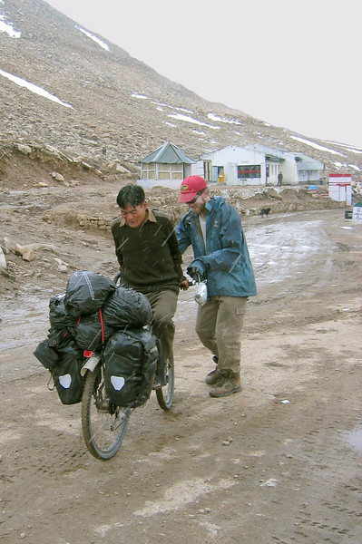 Photo courtesy of Gabe McGann. This soldier thought it was amusing to ride my fully-loaded bike backwards on a muddy road while it was snowing. I was sure he was going to crash, but he didn't!