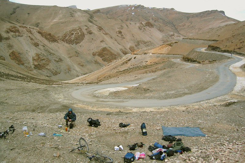 We camped halfway up the Taglang La on a switchback that afforded the only flat ground for miles. In the morning I woke up with altitude sickness: vomiting and diarrhea. The road ahead was above 14,000 feet for hundreds of kilometers so I knew there would be no respite from the thin air, but staying at our campsite wasn't going to help me either, and there was certainly no turning back. So I figured there was nothing to do but to get on the bike and keep going up...