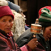 A Ladakhi woman spins a prayer wheel. With each spin, they believe, prayers are sent up to heaven.