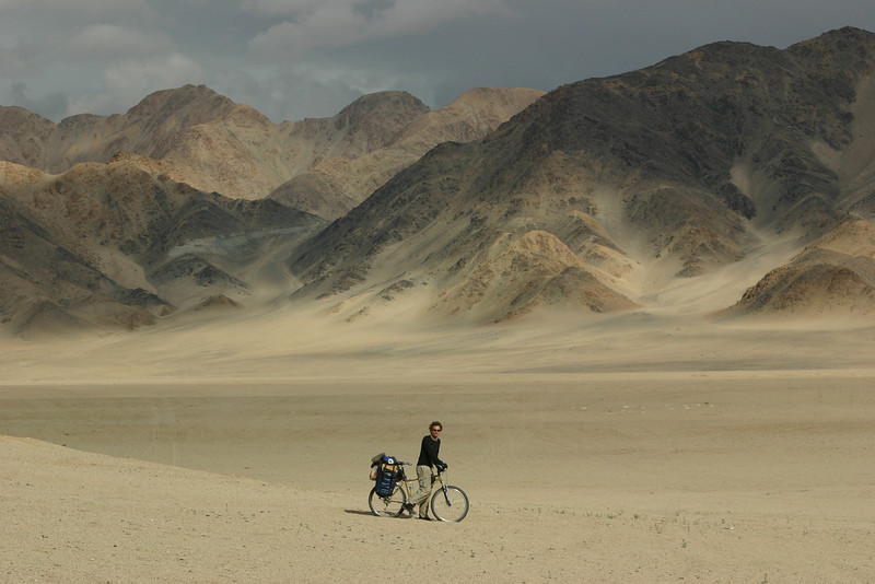 Gabe poses in front of a desolate moonscape in the Indus Valley