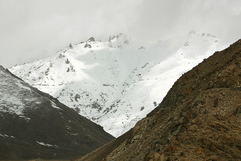 You can see the road to the pass snaking across the snowy mountainside. The summit of the pass is out of view on the left.