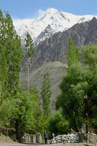 A minor peak of the Zanskar Range towers over over the road