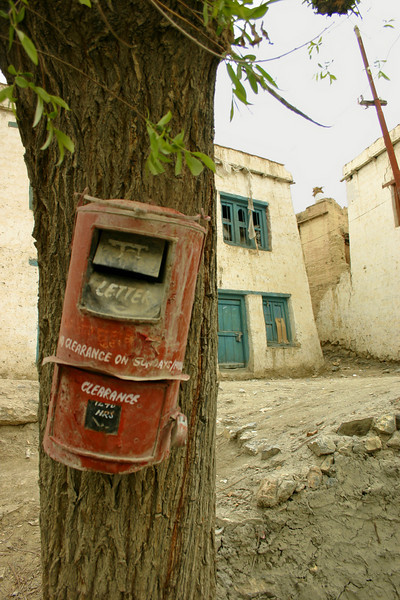 This mailbox was nailed to a tree in a small village