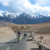 Photo courtesy of Gabe McGann. Cycling in the Indus Valley, heading towards Leh, with the Zanskar Range in the background.