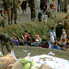 The Indian Army was busy distributing relief supplies too - often surrounded by frenzied crowds