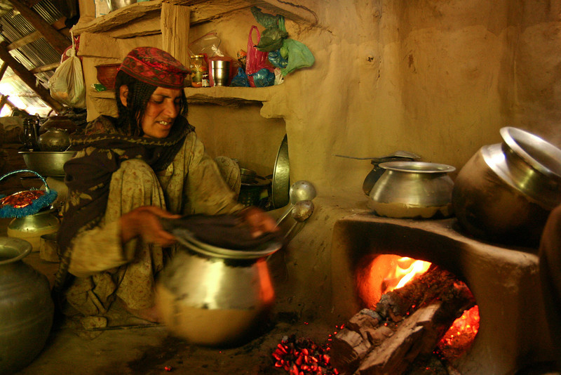 Cooking over a wood fire on an earthen stove