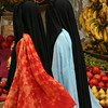 In certain towns, some women wear conservative black veils over their colorful clothing