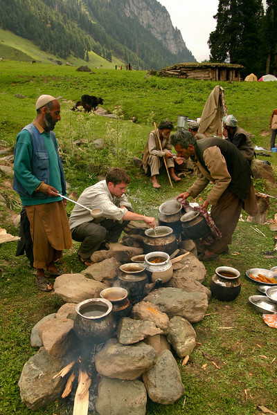 Cooking a feast of traditional Kashmiri dishes, outdoors in the mountains