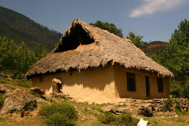A Kashmiri house with a traditional thatched roof is hard to find these days. Thatch has been almost universally replaced by that great sign of civilization, the tin roof.