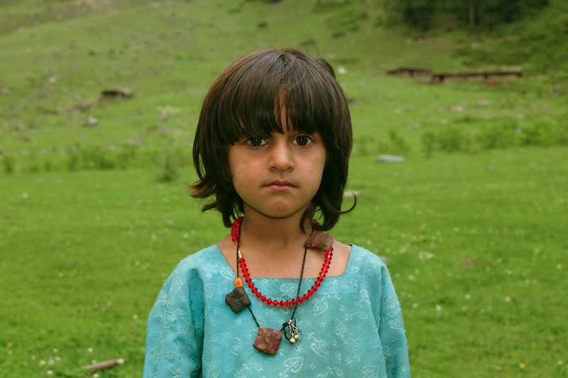 This little girl is wearing several tawiz, amulets containing Qur'anic verses designed to protect the wearer from evil