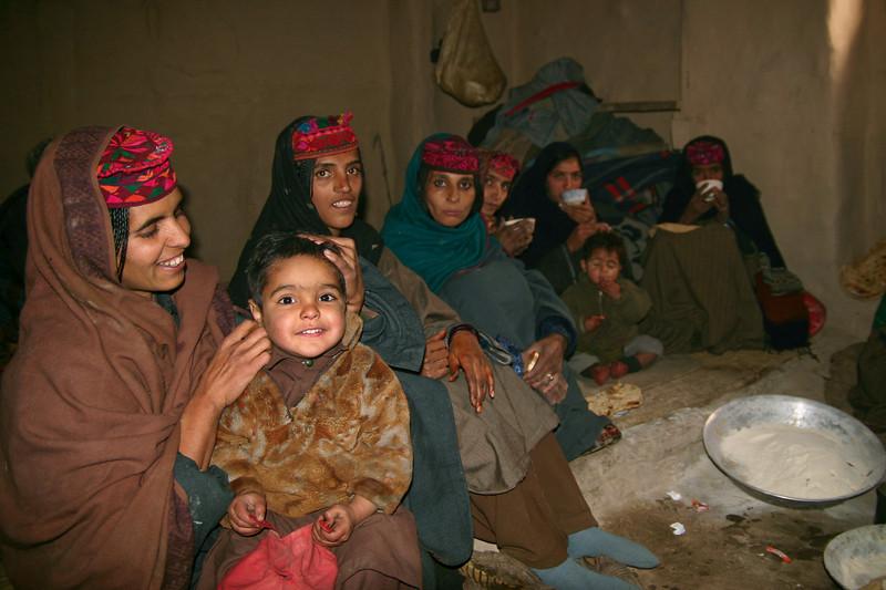 Gujjar women enjoying tea at a family gathering