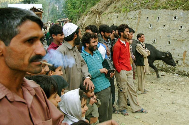 Kashmiri men pose for a photograph