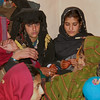 A young bride (in the black dress at left) gets ready to leave her family's home for good