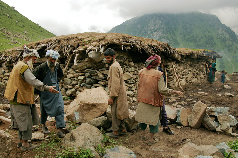We came across a group of men who were moving rocks for the foundation of a house. We were told that a house like the one behind them takes only a few days to complete. Men from several families will come over to help for free - and the beneficiary will return the favor when called upon.