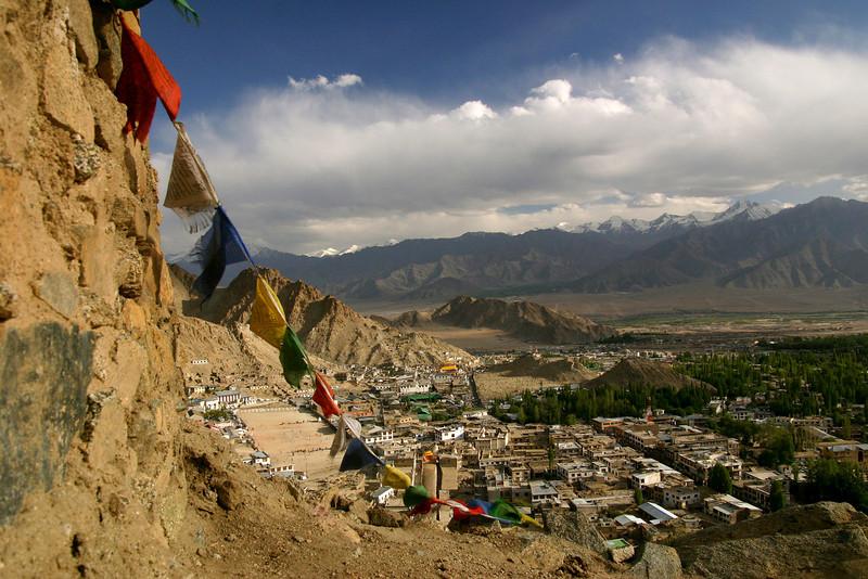 Tibetan prayer flags frame the town of Leh, the capital of the Ladakh region in Jammu & Kashmir