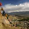 Tibetan prayer flags frame the town of Leh, the capital of the Ladakh region in Jammu & Kashmir