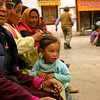 A little girl waits with her mom for a ceremony to begin at the main Buddhist temple in Leh