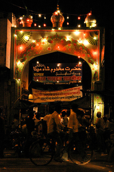 The brightly-lit entrance to a Sufi shrine in Lucknow