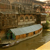 Many families in Srinagar live in large wooden houseboats, like this one