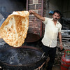 Photo courtesy of Erin. A chef flips a massive piece of deep fried flatbread!