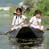 Photo courtesy of Erin. These girls, still in their uniforms, were rowing themselves home from school. Many families in Srinagar live on the lake - either on little islands or peninsulas or on houseboats.