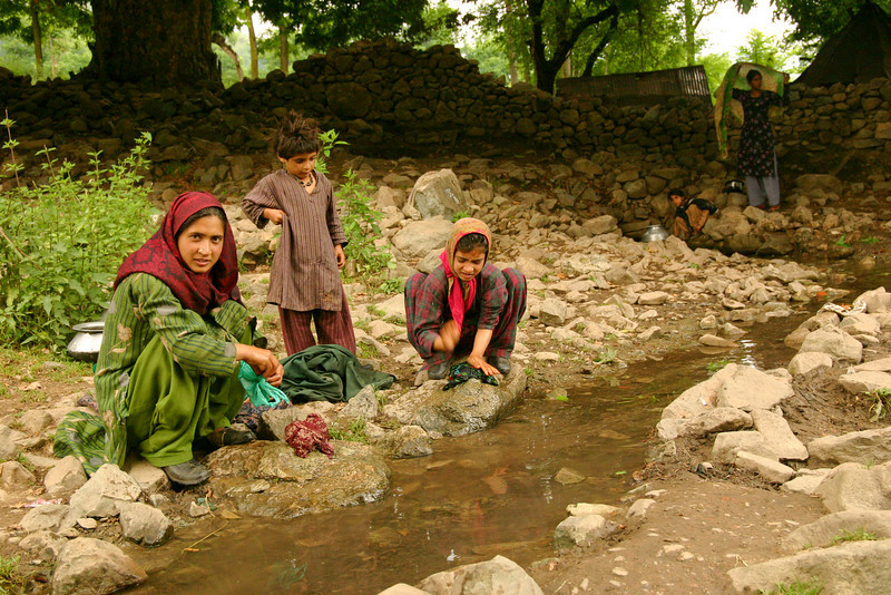 Washing clothes in a stream