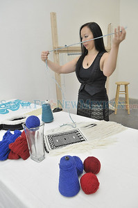 Lisa Hageman Yahgulanaas, of the Yahgulanaas clan of the Raven moiety of Haida Gwaii weaves a RavenÕs Tail at her workstation in the Santa Fe Arts Institute on Thursday, August 18, 2011. For the first time in 90 years, First Nation artists (from Canada) will participate in Santa Fe's Indian Market.  Lisa is the recipient of the SWAIA Residency Fellowship. In collaboration with the Santa Fe Art Institute, SWAIA has established the SWAIA Residency Fellowships-a one-month residency for Native artists during August 2011. Clyde Mueller/The New Mexican