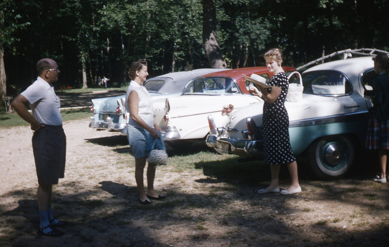 (L to R):  G. A. Shaffer, Ethel Henning, & Carol Henning Taake.  The green & white Studebaker belonged to the Hennings.  I believe it was a 1955 model.  The white Studebaker with red top belonged to us and was a 1957 model.