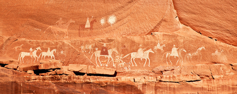 Panoramic photograph in Canyon De Chelly Arizona. This pictograph was done by an unknown Navajo artist in the 19th century. Possibly depicting Lt. Antonio Narbona and his Spanish force which battled the Navajos in 1805, massacring 115.