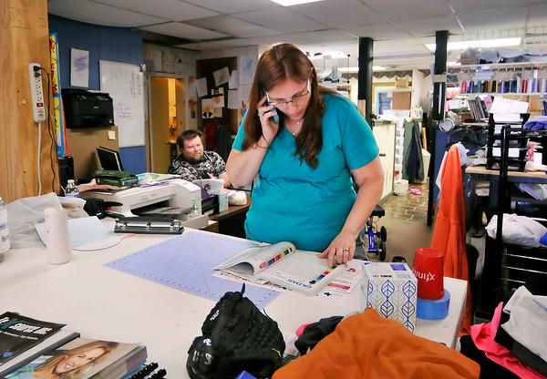 John P. Cleary | The Herald Bulletin  <br /> Tamra Rigdon and son Tim Senkowski work in their shop, Bulldog Creative Tees, where the proceeds go toward Indiana Warrior Alliance.