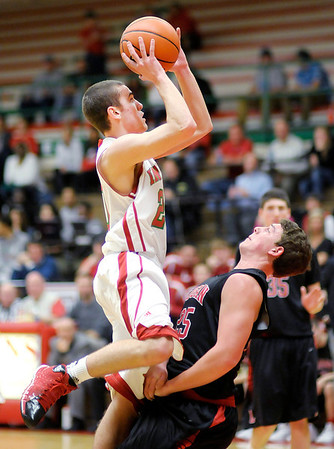 Don Knight / The Herald Bulletin<br /> Anderson's Grant Bennett shoots over Logansport's Andrew Wamsley on Friday.