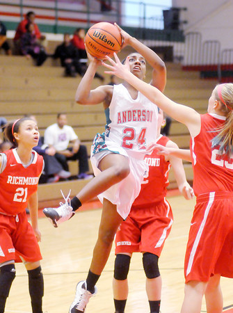 Don Knight / The Herald Bulletin<br /> Anderson's Dabriona Williams drives to the basket as the Indians hosted Richmond on Saturday.