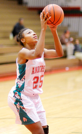 Don Knight / The Herald Bulletin<br /> Anderson's Ania Daniels shoots from the low post as the Indians hosted Richmond on Saturday.