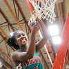 Don Knight / The Herald Bulletin<br /> Anderson's Donjanae Chamberlain cuts down a piece of the net after the Indians defeated Elwood to win the Madison County Championship on Tuesday.