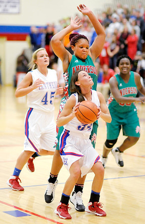 Don Knight / The Herald Bulletin<br /> Elwood's Jessie Noon shoots as she is guarded by Anderson's Kez'Anique Gosha as Anderson faced Elwood in the Madison County Championship game on Tuesday.