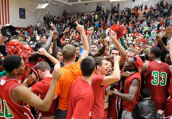 Anderson celebrates their 46-41 win over Pendleton Heights to win the County Championship on Friday.